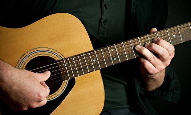 An asshole playing a guitar